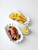 Curried sausage with ketchup, french fries and mayonnaise