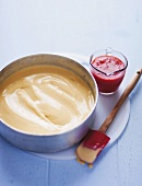 Frozen vanilla cream with strawberry puree