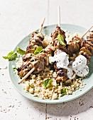 Eggplant-lamb skewers with yogurt on couscous