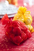 Red and yellow sacks of Christmas baubles