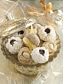 Assorted macaroons (almond, pineapple, coconut) in a crystal bowl