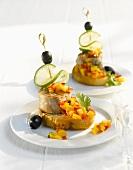 Pork medallions with mango salsa on white bread