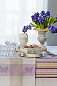 Crockery, eggs and blue hyacinths on a table