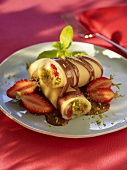 Sweet Cannelloni with strawberries, pistachios and chocolate sauce