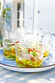 Ceviche on a patio table in front of a house