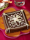 Chocolate cake decorated with a flower made with icing