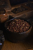 Szechuan pepper in a wooden bowl