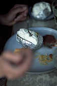 Baked potatoes in aluminum foil with sour cream