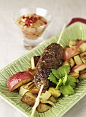 Cinnamon meatballs with roast potatoes and apples