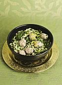 Kale soup with meatballs and lemon zest
