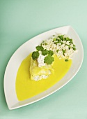Fish fillet with shrimp filling, saffron sauce and rice with peas