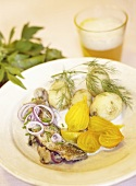 Cooked herring and mackerel with yellow beets, potatoes and dill