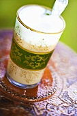 Chai Latte in a glass with an Asian design