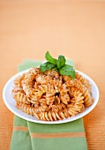 Corkscrew noodles with Pesto Rosso and basil