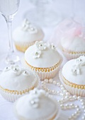 Wedding cupcakes and pearl necklace