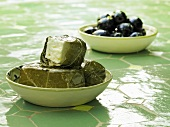 Stuffed grape leaves and olives in dishes