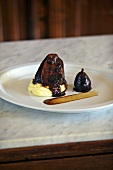 Stewed veal cheeks on mashed potato with figs