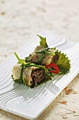 Marinated beef in a spring roll wrapper with Shiso leaves