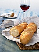 Baguette with a glass of red wine