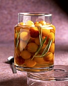 Preserved yellow plums with rosemary