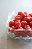 Raspberries in a plastic dish