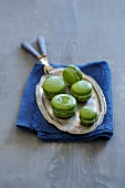 Pistachio macaroons on a silver tray