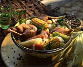 Pot au feu with chicken, vegetables and corn cobs