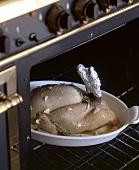 Trussed chicken in the oven