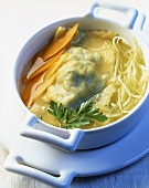 Broth with vegetables and turnovers filled with rabbit
