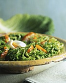 Savoy cabbage salad with poached egg and smoked herring