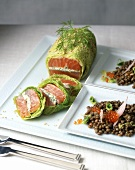 Salmon fillet wrapped in a savoy cabbage leaf with lentils and caviar