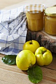 Two jars of quince jam and fresh quinces