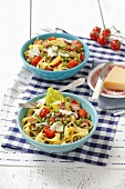 Tagliatelle with tomatoes, peas and pancetta