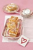 Apple strudel cake with meringue and powdered sugar