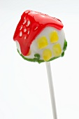 A colourful cake pop shaped like a house