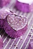 A purple-coloured, heart-shaped praline