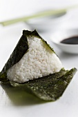 Onigiri (rice canape in a nori leaf filled with salmon, Japan)