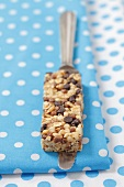 A muesli bar on a knife