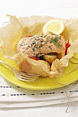 Salmon in parchment paper with potatoes and tomatoes