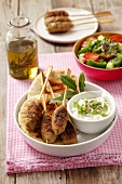 Kofta with pita bread, yogurt and vegetable salad