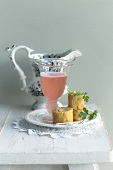 Prosecco with a rhubarb broth and omelette rolls with prawns