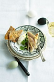 Smoked trout with creamy horseradish and crisp breads for Easter