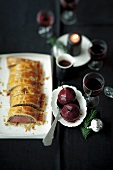 Venison Fillet Wellington with red wine pears