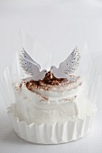 A chocolate cream tartlet decorated with two doves