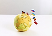 A map of Europe carved into a melon and stuck with flags