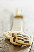 Black and white cookies on a knife