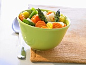 Mixed vegetables in a green bowl