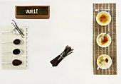 Vanilla extract, vanilla pods and creme brulee