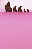 Chocolate Easter bunnies on a pink surface