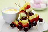 Fruit kebabs with a dip